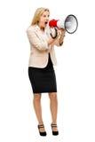 对magaphone呼喊负的成熟妇女被隔绝在白色backgr 免版税图库摄影
