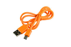 对USB缆绳的橙色微小USB 免版税库存照片
