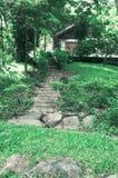 导致房子的一个美丽如画的楼梯在越南的密林 库存照片