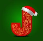 导航与圣诞节帽子和金雪花的字母表信件J 免版税图库摄影