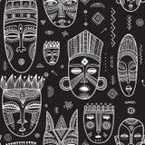 导航与非洲种族部族面具decorat的无缝的样式 库存照片