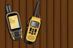 导航员和携带无线电话 免版税库存照片