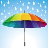 导航在彩虹颜色的伞和雨下落 库存图片