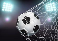 导航在目标网的足球在体育场 库存照片