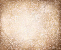 导航在老纸backgr的抽象花卉样式 库存照片