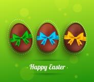 导航复活节与丝带的朱古力蛋在绿色 向量例证