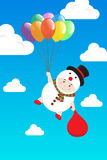 导航拿着在天蓝天的雪人服装的男孩五颜六色的气球 免版税库存图片