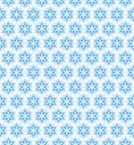 导航蓝色无缝的样式,与雪花的背景 库存照片