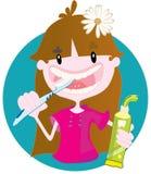 逗人喜爱的小女孩洗涤的牙 库存图片