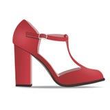 导航鞋子,有皮带的妇女` s红色低鞋子在高跟鞋,被隔绝 免版税库存照片