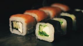 寿司两行在烟云的,在板岩板的卷,食物背景,日本烹调 影视素材