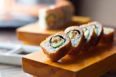 寿司卷在木头-图象服务 图库摄影
