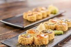 寿司卷被设置在寿司店 免版税库存照片