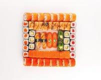 寿司和卷被设置在白色背景 免版税库存图片