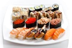 寿司在一块板材在白色背景中设置了 免版税库存照片