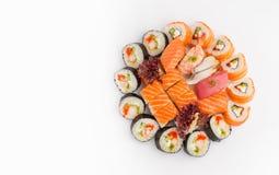 寿司套在被隔绝的白色背景的另外卷顶视图 图库摄影
