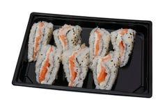 寿司将夹在中间与在白色背景隔绝的塑胶容器的交付 库存图片