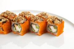 寿司美好的开胃卷在一块白色板材的 库存照片