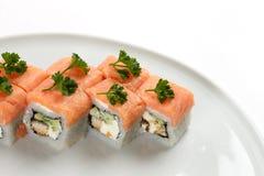 寿司美好的开胃卷在一块白色板材的 免版税库存图片