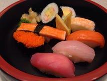 寿司集合生鱼片和寿司卷 库存图片