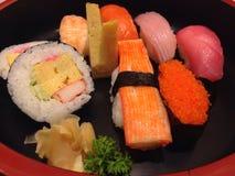 寿司集合生鱼片和寿司卷 库存照片