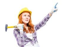 射击一个木匠` s图象的一名妇女在白色 免版税库存图片