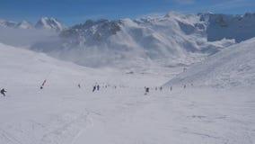 射击滑雪者在山进来下来在冬天的滑雪倾斜 影视素材