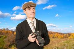 射击的横向的摄影师。 免版税库存图片