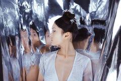 射击一名未来派年轻亚裔妇女 库存照片