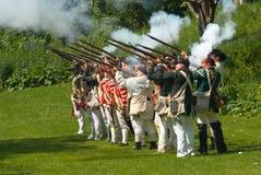 射击与步枪的旧时战士 免版税库存照片