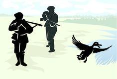 射击在鸭子的两位猎人 库存照片