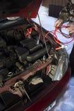 射击汽车在跨接电线的冬天 库存图片