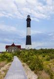 射击海岛灯塔的路 库存图片