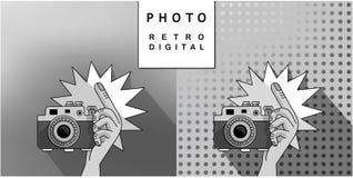 射击的手在照相机 库存图片