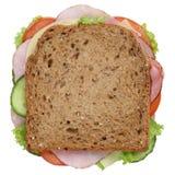 将多士面包夹在中间有火腿顶视图被隔绝的早餐 免版税库存照片