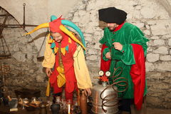 小丑和方士 库存图片