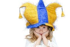 小丑帽子的小女孩 免版税库存照片