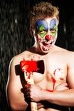 小丑构成的年轻人 免版税库存照片