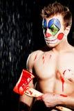 小丑构成的年轻人 库存照片