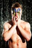 小丑构成的年轻人 免版税图库摄影
