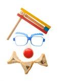 小丑的面孔-与Hamentashen的普珥节安排 库存照片