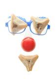 小丑的面孔-与Hamentashen的普珥节安排 免版税库存图片