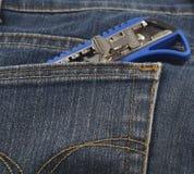 小刀子或切削刀在斜纹布的口袋 库存图片