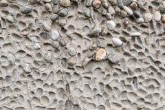 小卵石具体难看的东西石头纹理背景 免版税库存图片