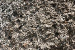 小卵石向多种纹理扔石头 库存图片