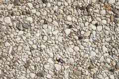 小卵石特写镜头在一个晴天向纹理扔石头 免版税图库摄影