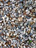 小卵石,岩石,石背景的领域 图库摄影