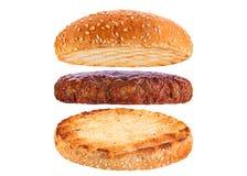 小圆面包和小牛肉鱼圆成份汉堡包 免版税图库摄影