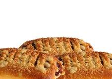 小圆面包用果酱和碎屑 免版税图库摄影