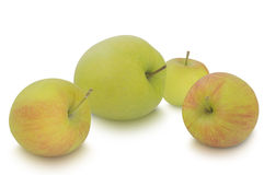 小在白色背景隔绝的苹果和大一个 库存照片